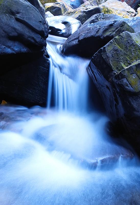 Water fall through rocks